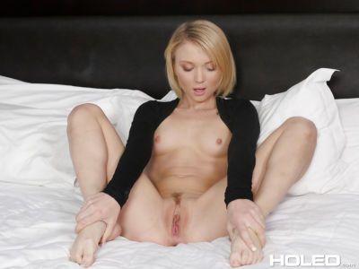 Thin blonde girl with short hair Dakota Skye inserting butt plug into anus
