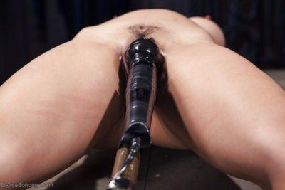 Asian cutie Mia Li gets masturbated against her will on bondage table - part 2
