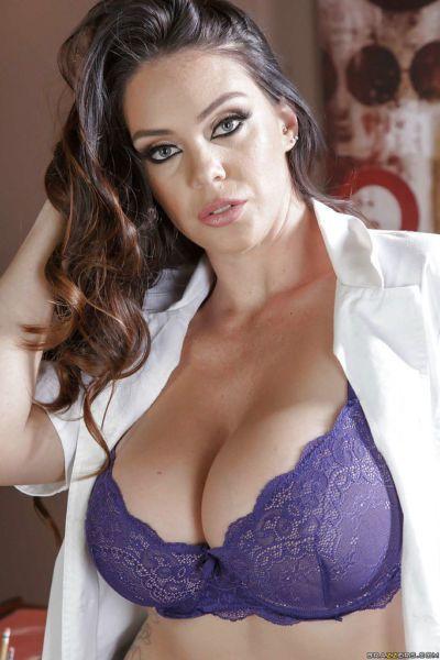 Chesty office worker Alison Tyler showing off juicy butt on desk
