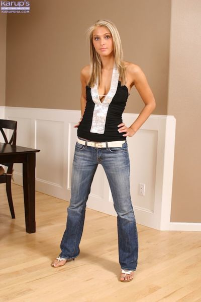 Stunning blondie in blue jeans undressing and teasing her inviting pussy